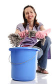 Housewife with cleaning supplies — Stock Photo