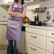 Housewife in her kitchen - Photo