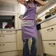 Housewife in her kitchen — Stock Photo #4470723