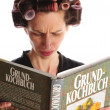 Housewife with cookbook — Stock Photo