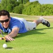 Young Golfer on green - Stock Photo