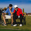 Two young golfers are frustrated - Stock Photo