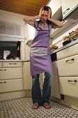 Housewife in her kitchen — Stock Photo