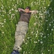 Foto Stock: Man in meadow relaxing