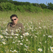 Man in meadow relaxing - Stok fotoğraf