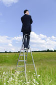 Manager outdoor on ladder — Stock Photo