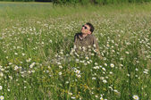 Man in meadow relaxing — Stock Photo