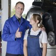Auto Repair, apprentice to master - Stock Photo