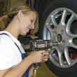Changing wheels in car workshop — Stock Photo #5032497