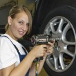 Changing wheels in car workshop — Stock Photo #5032553