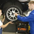 Stock Photo: Changing wheels in car workshop