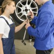 Changing wheels in car workshop - Foto Stock