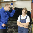 Royalty-Free Stock Photo: Female car mechanic happy