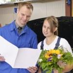 Female car mechanic happy — Stock Photo