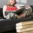 Cute girl on sofa - Stock Photo