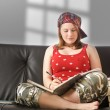 Cute girl on sofa — Stock Photo