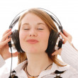 A cute girl listening music — Stock Photo #5140901