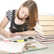 Stock Photo: Cute girl doing homework