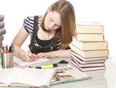 Cute girl doing homework — Stock Photo