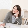 Young business woman on phone at office — Stock Photo #4680158