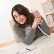 Happy businesswoman holding phone at office — Stock Photo