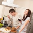 Young couple cooking in kitchen together — Stock Photo #4680392