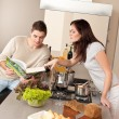Young couple cooking in kitchen together — Foto de Stock