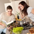 Young couple cooking in kitchen together — Stock Photo #4680398