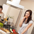 Young couple cooking in modern kitchen — Stock Photo #4680399