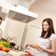 Young couple cooking in kitchen together — Stock Photo #4680401