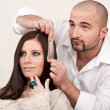 Professional hairdresser choose hair dye color at salon — Stock Photo