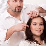 Professional hairdresser comb customer at salon — Stock Photo
