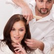 Professional hairdresser comb customer at salon — Stock Photo