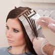 Professional hairdresser color customer at salon — Stock Photo