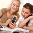 Student series - Two girls watching mobile phone — Foto de Stock