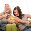 Students series - Two teenage girls having fun by television — Stock Photo