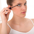 Body care series - young woman applying mascara — Stock Photo #4681607