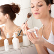 Body care series - Young beautiful woman with make-up brush — Stock Photo