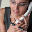 Businesswoman calling on the phone at office — Stock Photo