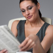 Royalty-Free Stock Photo: Successful businesswoman read newspaper at office