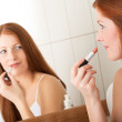 Body care series - Beautiful red hair woman applying lipstick — Stock Photo