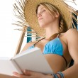 Beach - Happy young woman relax with book - Stock Photo