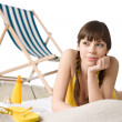 Beach with deck chair - Woman in bikini sunbathing — Stock Photo #4682177