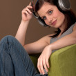 Student series - Beautiful young woman listening to music — Stock Photo