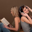Student series - Two students with book and headphones — Stock Photo
