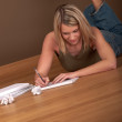 Student series - Blond young woman writing homework — Stock Photo #4682236