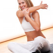 Fitness series - Smiling woman stretching — Stock Photo #4682609