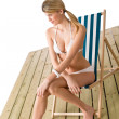 Beach - Woman in bikini sunbathing on deck chair — Foto de Stock
