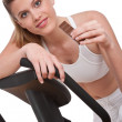 Fitness series - Woman holding piece of chocolate — Stock Photo