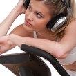 Fitness series - Woman with headphones exercising — Stock Photo